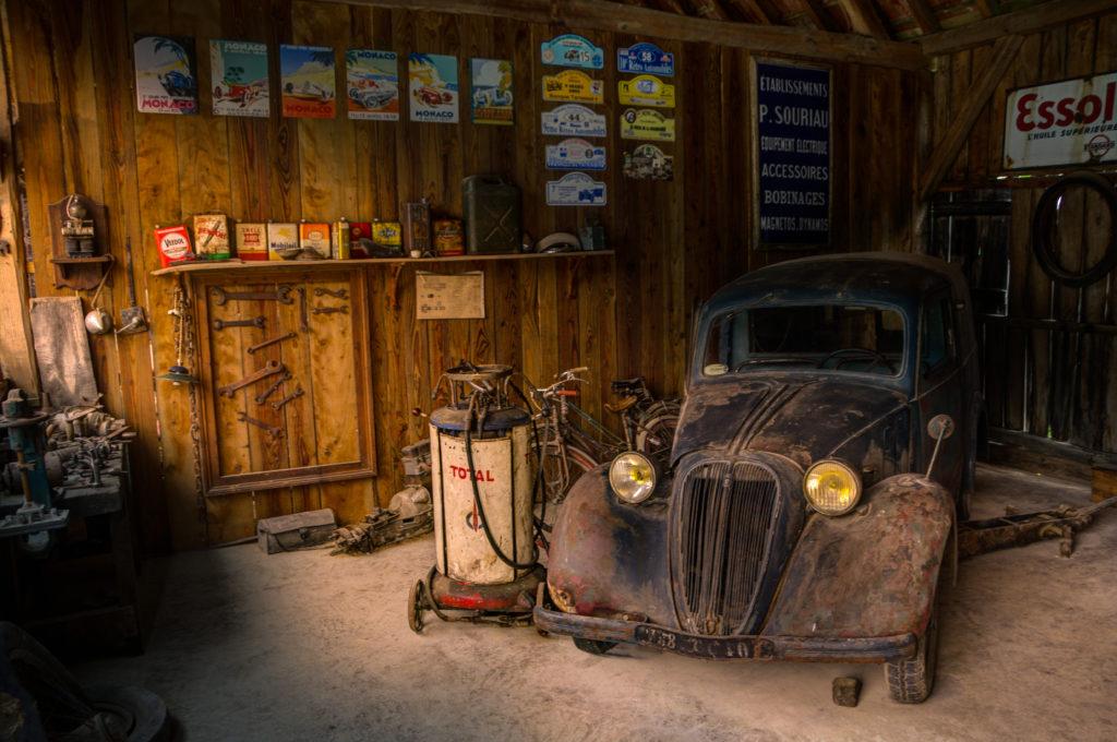 wooden garage with old black car