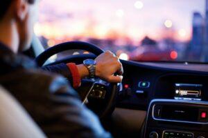 Man driving car at dusk