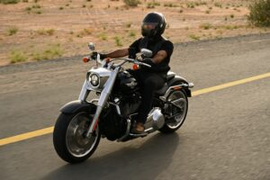 man in black riding a motorcycle